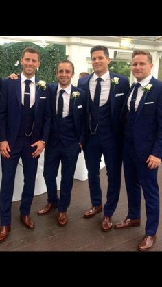 Mr neville 2015 the groom and 2 ushers are wearing royal blue made to measure suits and the rest of the groomsmen slim fit suits from our wedding suit hire range.