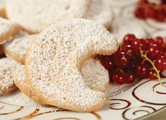 Viennese Crescent Cookies Recipe: A traditional butter cookie found in konditorei throughout Vienna, these sweet treats are great with a cup of strong coffee.This recipe calls for almonds, but you can substitute walnuts, hazelnuts or pecans. #VikingRiverCruises