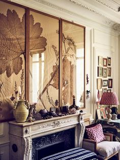 At her apartment, pressed gunnera leaves surmount a marble mantel laden with mineral specimens.
