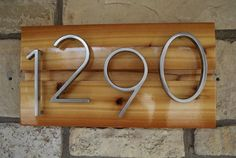 Hey, I found this really awesome Etsy listing at https://www.etsy.com/listing/124655323/mid-century-modern-custom-address-sign