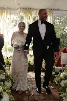 On Saturday, October actor and WWE Superstar Dave Bautista (Batista) married longtime girlfriend Sarah Jade in Tampa, Florida. He has been married twice before, with two daughters and two grandsons. Sarah Jade is a competitive pole dancer. Wwe Couples, Celebrity Couples, Celebrity Weddings, Wedding Pics, Wedding Bells, Batista Wwe, Dave Bautista, Star David, Wwe Champions