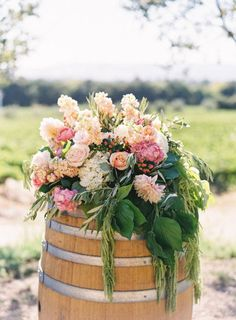 wine barrels overflowing with flora  Photography By / jessicaburke.com, Wedding Planning   Design By / asavvyevent.com, Floral Design By / fleuressence.net