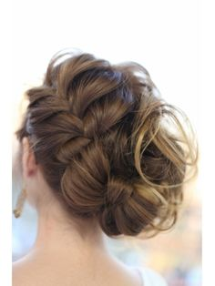 Updo- I like how the side is braided and then goes into a bow. I would not have all the loose hair sticking out the side.