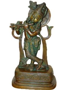 Spiritual Gift- Krishna Brass Statue Playing Flute Hindu God Sculpture 13 Inches by Mogul Interior, http://www.amazon.com/dp/B00CJ3T11A/ref=cm_sw_r_pi_dp_Cp9Mrb0GHPH88