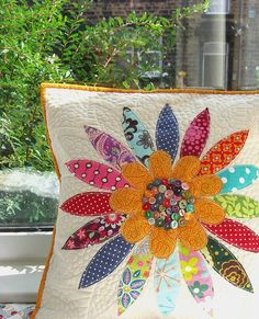 bright quilting- darling scrap flower pillow with button center Quilting Projects, Sewing Projects, Fabric Crafts, Sewing Crafts, Flower Pillow, Sewing Pillows, Quilted Pillow, Patchwork Cushion, Applique Quilts