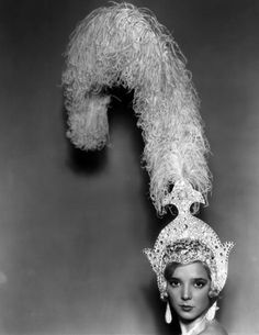 British actress Jessie Matthews – wearing a headdress decorated with ostrich feathers for her appearance in Charles B Cochran's musical spectacular 'Ever Green' at the Adelphi Theatre, London. Vintage Photography, Fine Art Photography, Photography Photos, Showgirl Costume, Elsa Schiaparelli, Showgirls, Headgear, Vintage Images, Burlesque