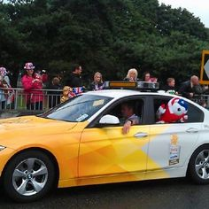 Olympic Torch Relay ~ Custom BMW Vehicle wrap. Love the 2 tone vectors overlay, great visual.