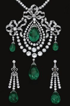 Important Emerald and diamond parure, circa 1900. Comprising: a pendant/devant de corsage in the Garland style, composed of three bows millegrain-set with circular- and single-cut diamonds, each suspending an emerald drop capped by rose stones, the central swing motif to a double frame of similar diamonds, embellished with a diamond set swag suspending another emerald drop, together with a pair of matching earrings, and a diamond set necklace, mounted in platinum, French assay marks.
