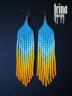 Beautiful beaded modern blue and yellow earrings with fringe, like Ukrainian flag) Very lightweight. Fusion between ethnic style and modern elements. Original design.  Measurements: Length - 8,5 cm Width - 2 сm  Materials: Silver plated ear hooks Czech glass beads Nylon Thread Patience and Creativity!:)  .. ready to be given away !  Contact me if you have any questions. I will be happy to answer :)