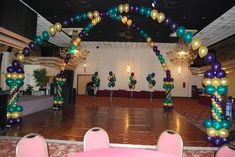 Mardi Gras String of Pearl Balloon Arches with columns on corners of dance floor