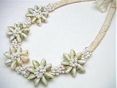 Hawaiian Jewelry Cowry Shell Lauhala Necklace / Choker East of Maui Hawaiian Store,http://www.amazon.com/dp/B0053DAN0G/ref=cm_sw_r_pi_dp_Uxbstb0VN0SJ5ZKG