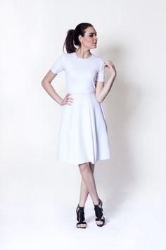 With neoprene dress by Oseas Villatoro