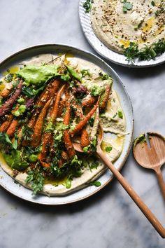 Dukkah roasted carrot salad with herbed tahini sauce and zucchini hummus (FODMAP friendly, vegan) - Georgeats - Dukkah and honey roasted carrot salad with FODMAP friendly hummus and a green herb sauce from www. Roasted Carrot Salad, Honey Roasted Carrots, Vegetarian Recipes, Cooking Recipes, Healthy Recipes, Vegetarian Cooking, Beef Recipes, Cooking Tips, Zucchini Hummus