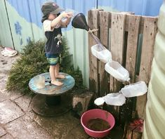 Young kids will love this water play idea! Just use recycled bottles. Then attach them to a fence or old pallet. Water Play For Kids, Kids Outdoor Play, Outdoor Play Areas, Outdoor Activities For Kids, Kids Play Area, Backyard For Kids, Summer Activities, Outdoor Games, Family Activities