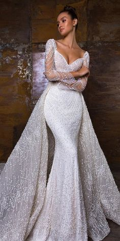 A sophisticated long sleeve column dress with re… Crystal Design: PENELOPE dress. A sophisticated long sleeve column dress with removable overskirt. Sweetheart Wedding Dress, Dream Wedding Dresses, Bridal Dresses, Wedding Gowns, Bridesmaid Dresses, Mermaid Sweetheart, Lace Wedding, Mermaid Wedding Dress With Sleeves, Crystal Wedding Dresses