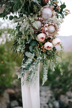 We're kind of obsessed with Protea wedding flowers right now, so we're taking a look at this trendy flower, with 20 gorgeous Protea bouquets to inspire you. Protea Bouquet, Eucalyptus Bouquet, Peonies Bouquet, Protea Flower, Cake Bouquet, Seeded Eucalyptus, Eucalyptus Wedding, Protea Wedding, Tropical Flowers