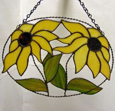 The beautiful yellow sunflowers suncatcher is 10 inches wide x 7 1/2 inches tall.  It is complete with chain attached for easy hanging in a window or your favorite place.  The Sunflower petals are wra