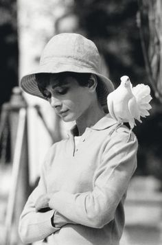 Audrey Hepburn must have really, really loved animals, because there are so many pictures of her with animals.