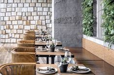 The passing of time let us see the design of this concrete panel, which imitates worn concrete exposed to weather conditions. Panel, Concrete, Table Settings, Commercial, Design, Weather Conditions, Fiber, World, Restaurants