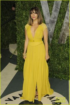 """Rashida Jones - Vanity Fair Oscar Party 2012 - """"a yellow gown with deep v-neckline, subtle pleats, lace details at the shoulder and a thin leather belt by Elie Saab"""", Jimmy Choo heels."""