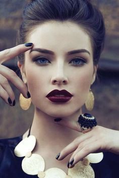 "Wow! Gorgeous girl with dark red lip color. Plum. It's plum, not ""dark red"". Silly me. :)"