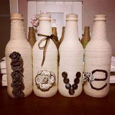 Jute twine repurposed bottles. Love. https://www.facebook.com/insightsgallery https://www.facebook.com/photo.php?fbid=10153946556993496
