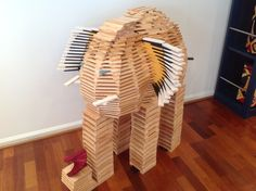 KAPLA Elephant smelling the flowers.  What kind of animal will you be building with your KAPLA blocks from Santa? #kids #blocks #gifts