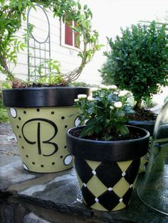 Painted Pots , I wanted some planters and pots to coordinate with a table I painted and some new outdoor cushions, but could not find anything I liked, so... DIY!  , I made a stencil for the monogram, but handpainted the details and other designs as I went along.  , Other Spaces Design