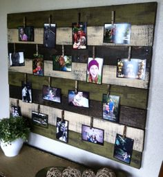 Family photo display made with pallets and clothes pins...change pics easily and often!