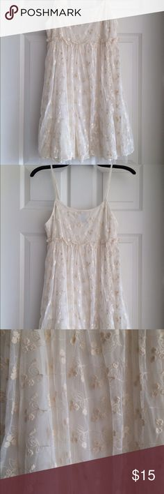 Beautiful Cream Lace & Tulle Flirty Dress This is such a pretty and feminine dress! Lined underneath the lace and tulle. Never worn, size Small. Wet Seal Dresses Mini
