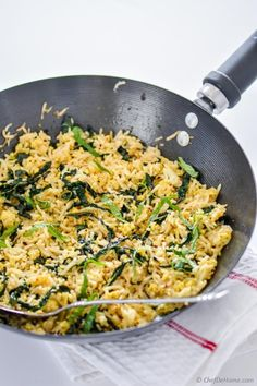 A Vegan bowl of Kale Fried Rice with egg-style scrambled tofu and hearty delicious kale | chefdehome.com