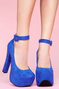 Crazy tall cobalt faux suede platforms featuring a chunky heel and covered platform. Buckled ankle strap, rounded toe. Liv Platform.