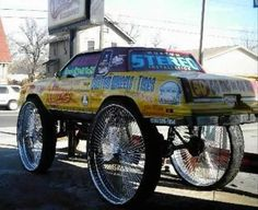 Biggest rims in the world: Cutlass on 50s - Tampa Bay sports car