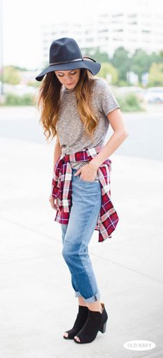 Blogger Megan of Lush to Blush does fall style right in boyfriend jeans, a heather-grey tee, black felt hat and a red plaid flannel tied around the waist.