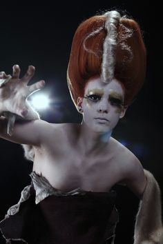 Futuristic Hair & Make-up with gold effects.