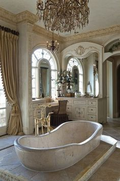 I would love to take a bath in this luxurious spa bathroom with the beautiful view of tassel trimmed draperies!