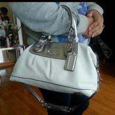 """*2xHP* 03/20&12/09 White and Silver Coach Purse *HP* 03/20 White and Silver Coach Purse HP - WORK WEEK CHIC In excellent mint condition. Don't have a dust bag though. Only used 3-4 times. Approximate measurements: Height-8.5""""; Length-13""""; Width-5.5; Strap Drop(handle) 4.5"""", Removable Strap-10"""" Coach Bags"""