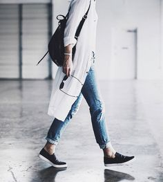 A great casual combo … distressed jeans, white long shirt-dress & tank top + black slip-on sneakers & back-pack | photos by John Hillin of Mary @ Happily Grey. x debra   follow on Bloglovin'