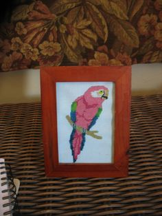 first attempt at cross stitch ....did this free hand for my parrot head momma