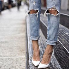 slim straight skinny / distressed jeans / vintage remade denim / accessorized with pointy toe white pumps / dress it up