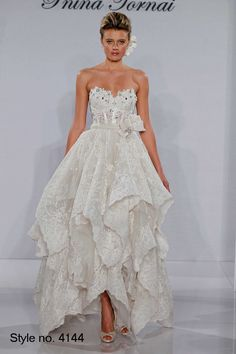 Pnina Tornai Sweetheart Tea Length Gown in Lace This tea length gown features a sweetheart neckline with a basque waist in lace and beaded embroidery. It has no train. This gown is Exclusive to Kleinfeld Bridal.