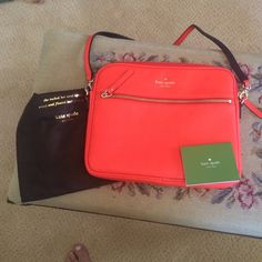 Kate Spade neon orange iPad case. Like new cond. Kate Spade leather iPad case. Includes strap, dust bag, and Kate Spade authenticity card. Beautiful neon orange. No spots, tears, or marks kate spade Bags