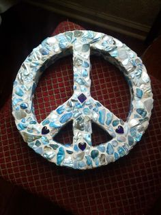 diy peace sign.. i hot glued the shells and then grouted..fun and messy