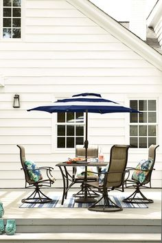 Keep your patio looking and feeling cool with a navy and white striped umbrella. Click to shop this fresh patio collection!