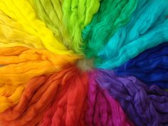 Rainbow-dyed wool.  I remember I used to use this type of yarn for ribbons in my hair back in elementary school~
