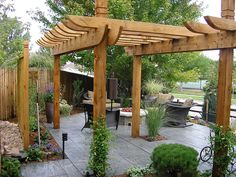 Pergola, Patio, Fire pit... only thing missing is the jacuzzi