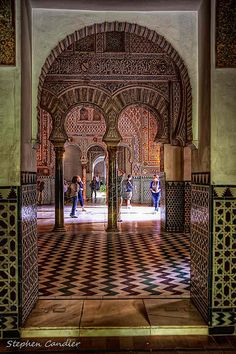 Arches leading to an interior courtyard in the Alcazar, Seville, Spain