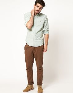 This oxford shirt by Polo Ralph Lauren has been styled with chinos.