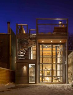 This conversion and addition of a two-flat in the hip Wicker Park neighborhood of Chicago incorporates a sizable glass wall on its rear elevation.