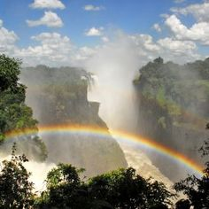 Victoria Falls with a rainbow in the background. #Africa #waterfall  http://theexplorerclubafrica.com/victoria-falls-activities.php